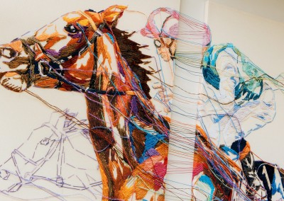 Each panel of the tryptic graphically inspired piece is woven together using multicoloured thread.