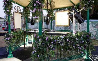 Green and gold bandstand with floral dressing
