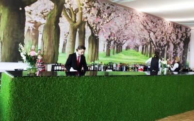 Real grass bar and bespoke graphic backdrop with gold leaf embellishments